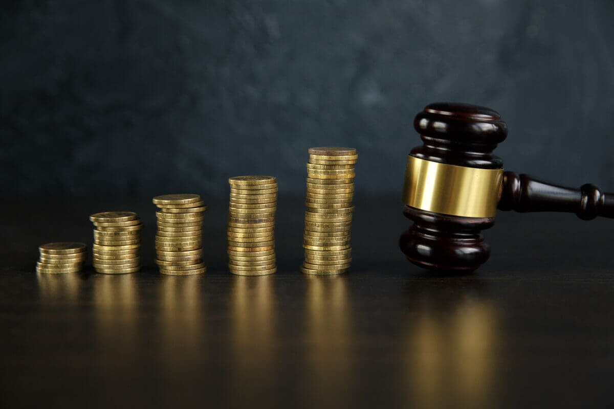 Judge gavel and gold coins