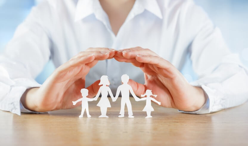 4 Types of Insurance - hands protecting paper cut-out family