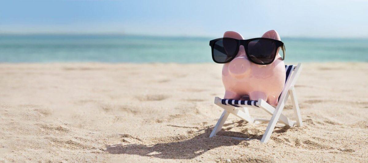 A pig with a sunglass having a vacation on a beach